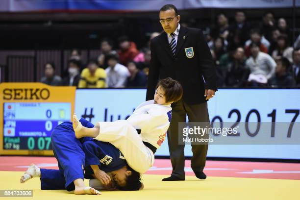 Tsukasa Yoshida of Japan competes against Anzu Yamanoto of Japan in the Women's 57kg Final during day one of the Judo Grand Slam Tokyo at Tokyo...