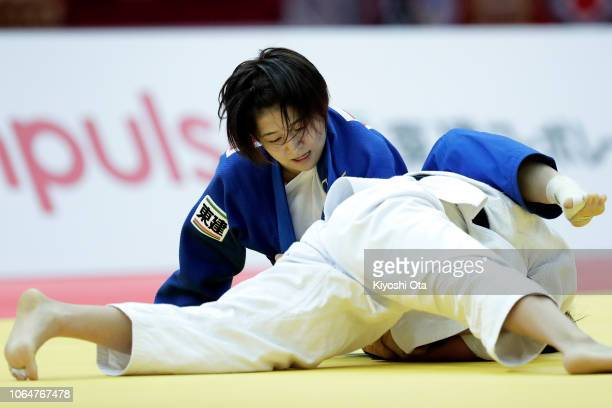 Tsukasa Yoshida of Japan competes against Kwon Youjeong of South Korea in the Women's 57kg bronze medal match on day two of the Grand Slam Osaka at...