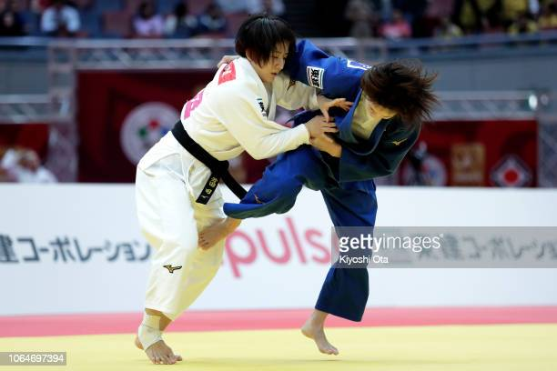 Tsukasa Yoshida of Japan competes against Momo Tamaoki of Japan in the Women's 57kg semifinal match on day two of the Grand Slam Osaka at Maruzen...