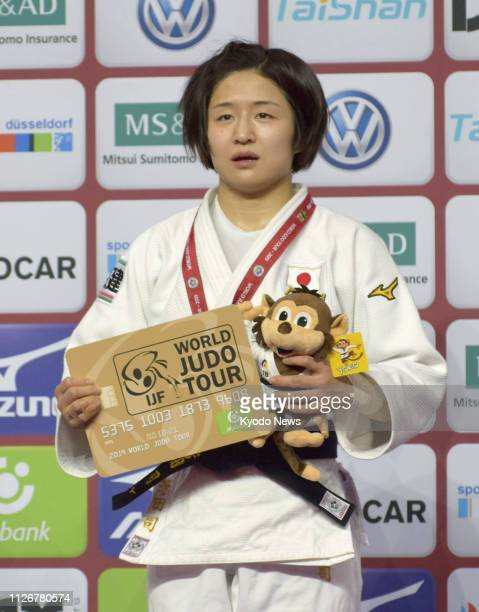 Tsukasa Yoshida of Japan poses for photos after winning the women's 57kilogram final at a Grand Slam judo event in Dusseldorf Germany on Feb 22 2019...