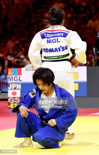 Tsukasa Yoshida of Japan shows dejection after her defeat by Dorjsurengiin Sumiyaa of Mongolia in the Women's 57kg final during day three of the...