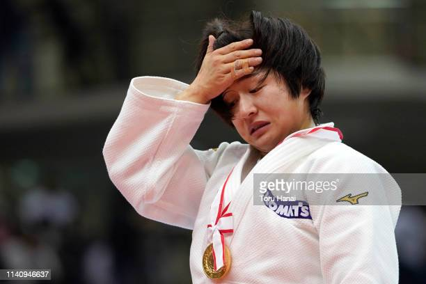 Tsukasa Yoshida reacts after receiving her gold medal at a medal ceremony after the Women's 57kg final match during day two of the All Japan Judo...