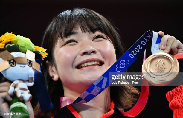 Tsukimi Namiki of Team Japan poses for a photo with her bronze medal during the medal ceremony for the Women's Fly on day fifteen of the Tokyo 2020...