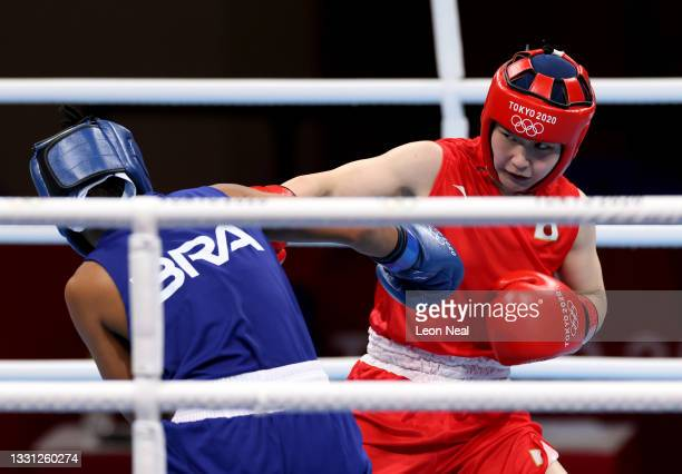 Tsukimi Namiki Team of Japan exchanges punches with Graziele Sousa of Team Brazil during the Women's Fly on day six of the Tokyo 2020 Olympic Games...