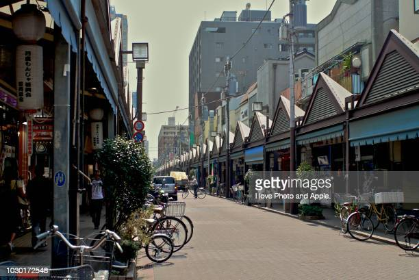 tsukishima monja street - retail place stock pictures, royalty-free photos & images