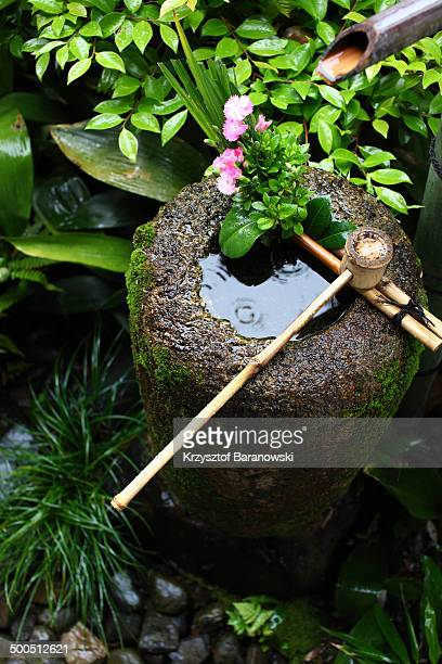 Tsukubai is a small water basin, provided in Japanese Buddhist temples for ritual cleansing.