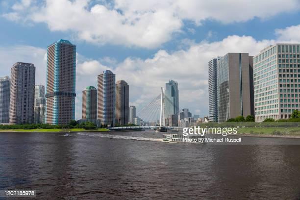 tsukuda skyscrapers and the chuo-ohashi bridge - 永代橋 ストックフォトと画像