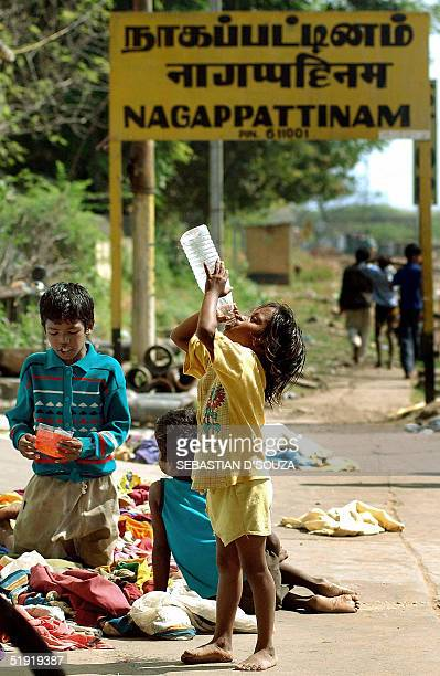 TRAUMA Tsunami affected Indian children drink water on the platform of the railway station at Nagapatitnam06 January 2005 More than 6000 villagers...