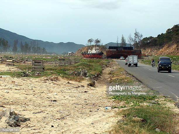 tsunami roadblock - tsunami aceh stock photos and pictures