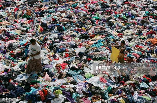 Tsunami survivors search for clothes at a camp for displaced villagers on January 3 2005 in Takua Pa Phang Nga province Thailand Eight days after a...