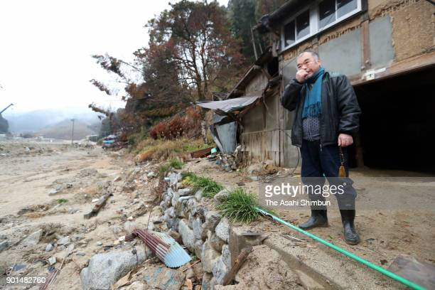 Tsunehiko Moriyama who lost his mother elder brother and sister in law visit the damaged home to commemorate them on the 6 months anniversary of the...