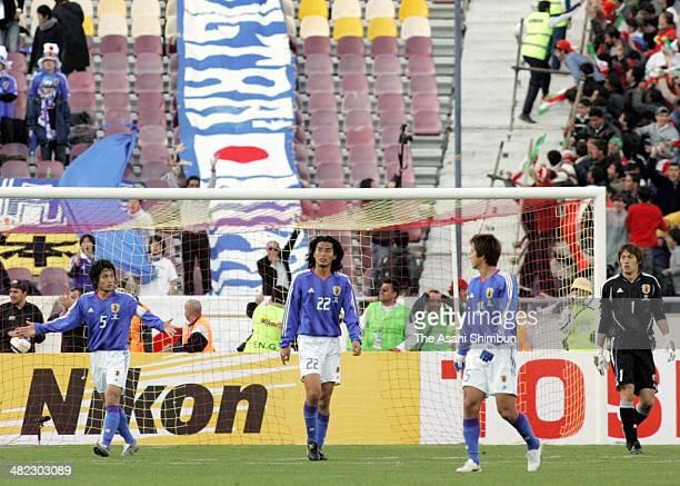 Tsuneyasu Miyakoto Yuji Nakazawa Takashi Fukunishi and Seigo Narazaki of Japan show their frustration after conceding the first goal to Iran during...