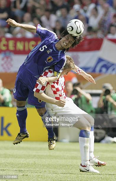Tsuneyasu Miyamoto of Japan battles for the ball with Ivan Klasnic of Croatia during the FIFA World Cup Germany 2006 Group F match between Japan and...