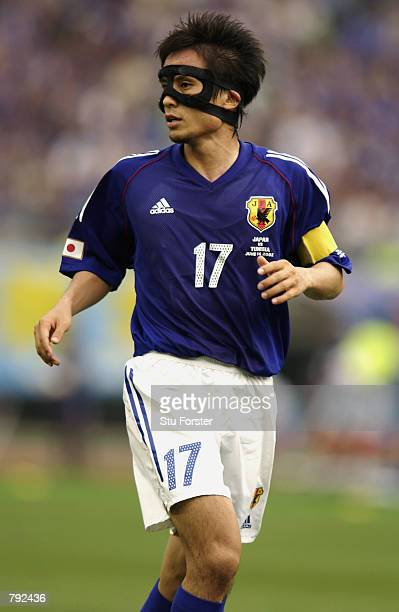 Tsuneyasu Miyamoto of Japan in action during the FIFA World Cup Finals 2002 Group H match between Japan and Tunisia played at the OsakaNagai Stadium...