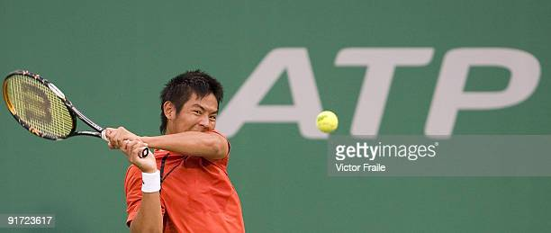 TsungHua Yang of Taiwan returns a ball against Marco Chiudinelli of Switzerland during the Day 1 of the 2009 Shanghai ATP Master 1000 at the Qi Zhong...