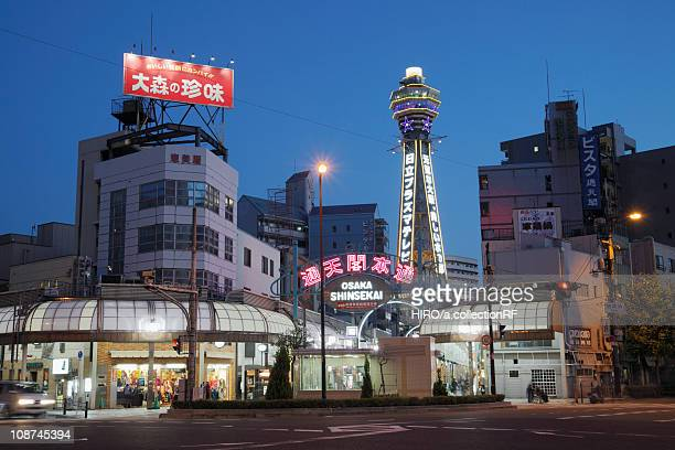 tsutenkaku tower at night, osaka prefecture, honshu, japan - 通天閣 ストックフォトと画像