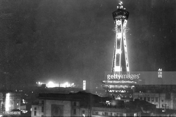 Tsutenkaku Tower is illuminated for the first time in 15 years on July 22, 1957 in Osaka, Japan.