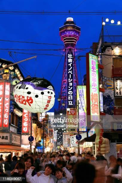 Tsutenkaku Tower is illuminated to celebrate the new era 'Reiwa' on May 1, 2019 in Osaka, Japan. New Emperor Naruhito formally inherits the imperial...
