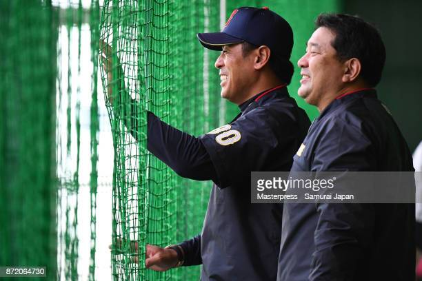 Tsutomu Ito and Atsunori Inaba of Samurai Japan smiles during a Japan training session on November 9, 2017 in Miyazaki, Japan.