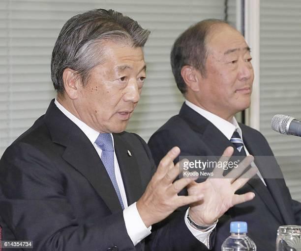 Tsuyoshi Kameoka chief executive officer of Showa Shell Sekiyu KK speaks at a news conference in Tokyo on Oct 13 as Takashi Tsukioka chief executive...