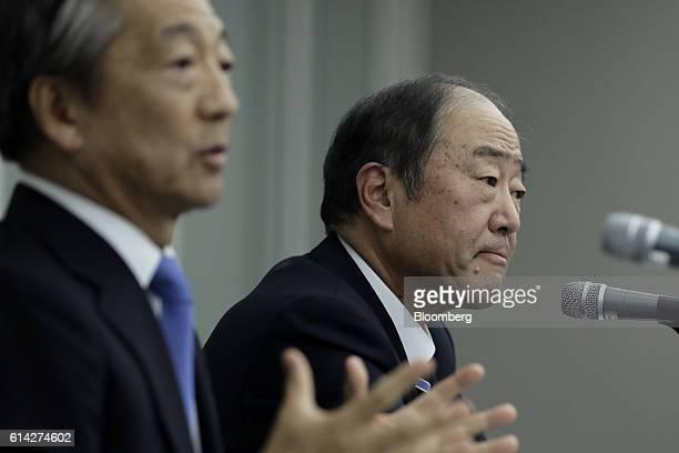 Tsuyoshi Kameoka chief executive officer of Showa Shell Sekiyu KK left gestures as he speaks as Takashi Tsukioka president of Idemitsu Kosan Co looks...