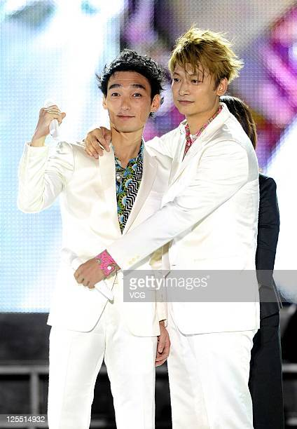 Tsuyoshi Kusanagi and Shingo Katori of Japanese boy band SMAP perform on the stage at Beijing Concert at Beijing Workers Stadium on September 16 2011...