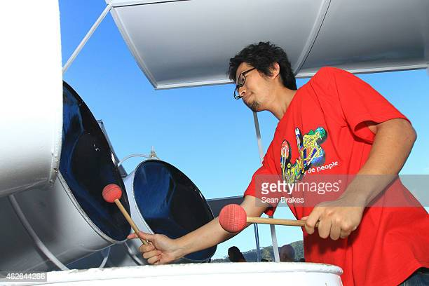 Tsuyoshi Makita of Japan peforms with Birdsong Steel Orchestra during National Panorama Semi-Finals in the Queens Park Savannah as part of Trinidad...