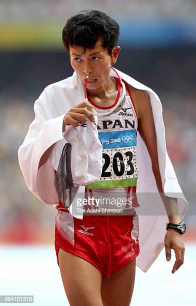 Tsuyoshi Ogata of Japan reacts after competing in the Men's Marathon held at the National Stadium during day sixteen of the Beijing 2008 Olympic...