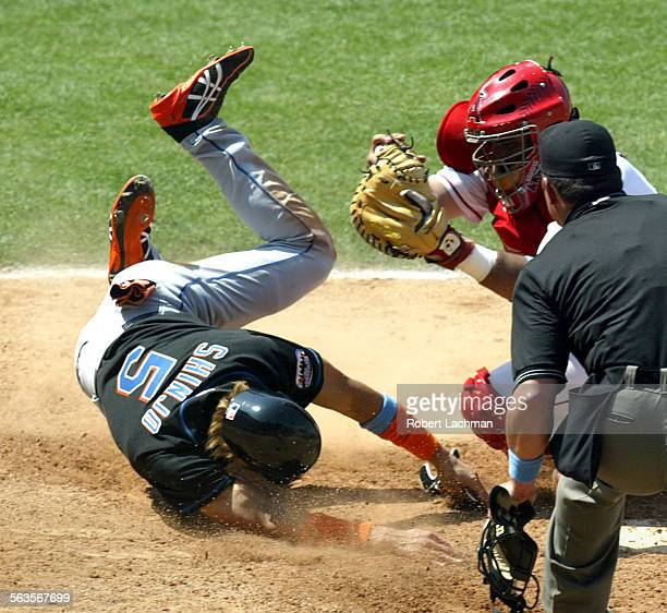 Tsuyoshi Shinjo of the Mets is tagged out at the plate by Angels' catcher Bengie Molina in the 8th inning at Edison Field Shinjo was trying to score...