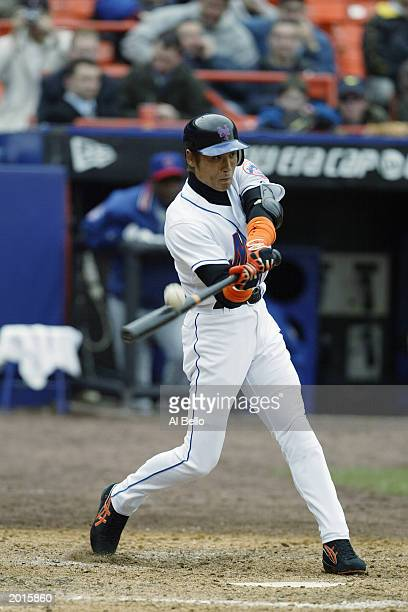 Tsuyoshi Shinjo of the New York Mets hits the ball during the game against the Chicago Cubs at Shea Stadium on April 3 2003 in Flushing New York The...