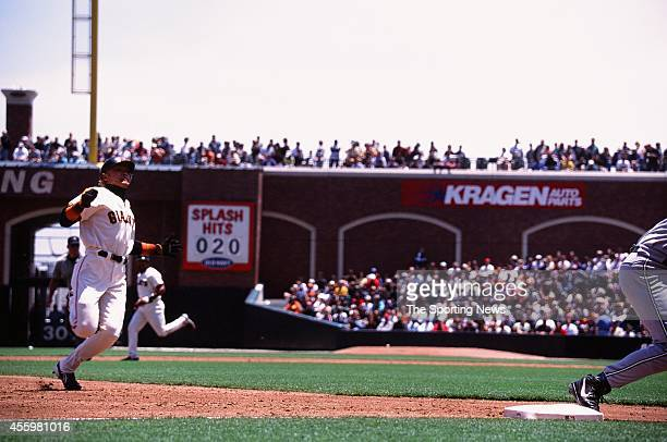 Tsuyoshi Shinjo of the San Francisco Giants slides against the Tampa Bay Rays during the game at Pacific Bell Park on June 20 2002 in San Francisco...