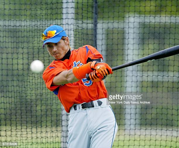 Tsuyoshi Shinjo takes his cuts in the batting cage at the New York Mets' spring training camp in Port St Lucie Fla