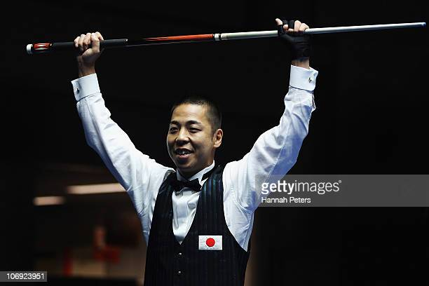 Tsuyoshi Suzuki of Japan celebrates winning gold in the Men's Carom 3 Cushion Singles Final against Joji Kai of Japan during day five of the 16th...