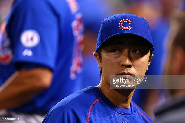 Tsuyoshi Wada of the Chicago Cubs looks on from the dugout in the seventh inning during a game between the St. Louis Cardinals and the Chicago Cubs...