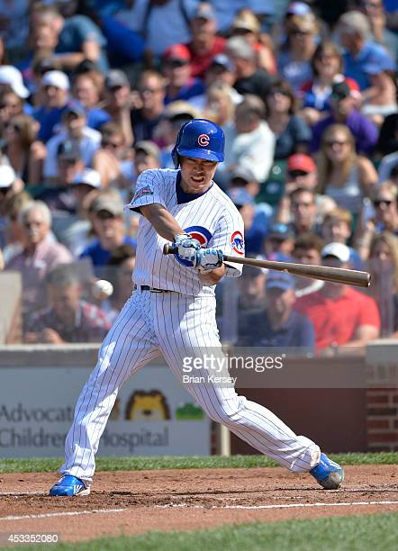 Tsuyoshi Wada of the Chicago Cubs puts the ball in play during the second inning against the Tampa Bay Rays at Wrigley Field on August 8 2014 in...
