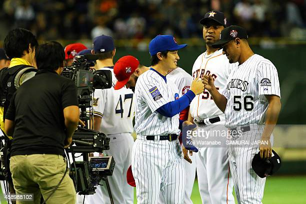 Tsuyoshi Wada of the Chicago Cubs team line up during game two between Samurai Japan and the MLB AllStars at Tokyo Dome on November 14 2014 in Tokyo...