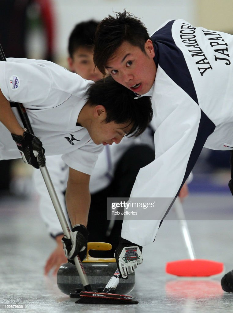 Tsuyoshi Yamaguchi and Kosuke Morozumi of Japan sweep the ice during the Pacific Asia 2012 Curling Championship at the Naseby Indoor Curling Arena on November 24, 2012 in Naseby, New Zealand.