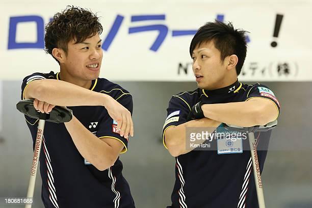 Tsuyoshi Yamaguchi and Kosuke Morozumi of SC Karuizawa speak during Game Two of the Curling Japan Qualifying Tournament between SC Karuizawa and...