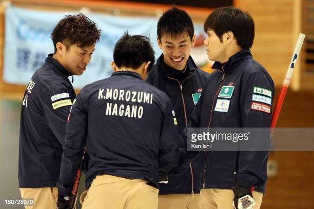 Tsuyoshi Yamaguchi Kosuke Morozumi Tetsuro Shimizu Yusuke Morozumi of SC Karuizawa congratulate during Game Three of the Curling Japan Qualifying...
