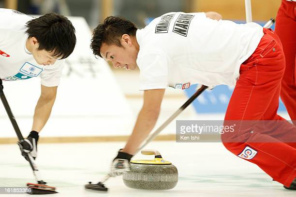 Tsuyoshi Yamaguchi of SC Karuizawa Club brushes the ice in the Men's Final Match during the 30th All Japan Curling Championships at Dogin Curling...