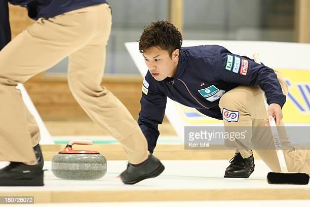 Tsuyoshi Yamaguchi of SC Karuizawa throws a stone during Game Three of the Curling Japan Qualifying Tournament between SC Karuizawa and Sapporo at...