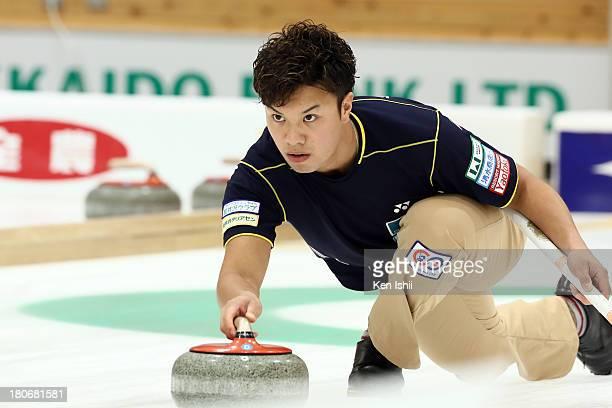 Tsuyoshi Yamaguchi of SC Karuizawa throws a stones during Game Two of the Curling Japan Qualifying Tournament between SC Karuizawa and Sapporo at...