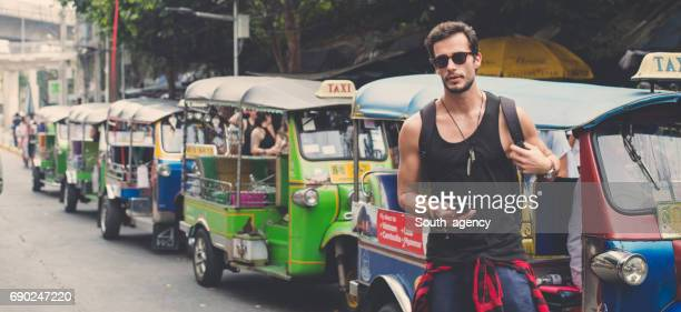 ttaveler on the street downtown - sleeveless top stock pictures, royalty-free photos & images