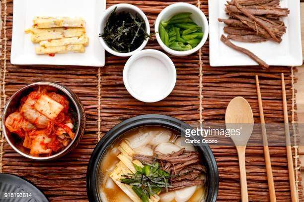 TORONTO ON FEBRUARY Tteoguk Korean rice cake soup Chef Sang Kim making traditional dishes for Seollal Korean Lunar New Year F