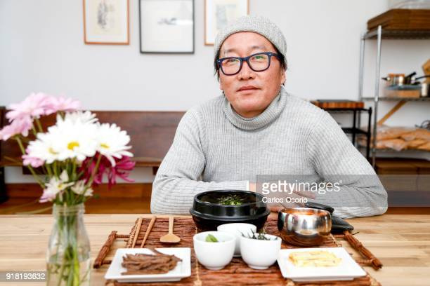 TORONTO ON FEBRUARY Tteoguk Korean rice cake soup Chef Sang Kim making traditional dishes for Seollal Korean Lunar New Year