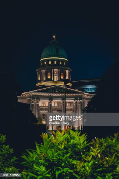 tthe national gallery of singapore at night. - rotunda stock pictures, royalty-free photos & images
