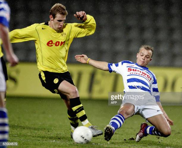 Ttja van Leerdam of de Graafschap duels for the ball with Borussia Dortmundplayer Florian Kringe during the benefit match De Graafschap vs Borussia...