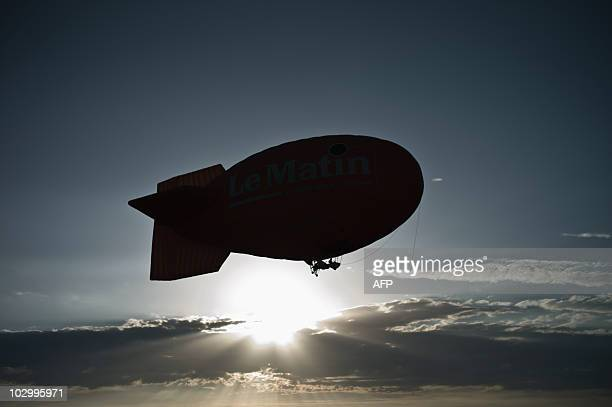 tTO GO WITH AFP STORY BY ANGELA SCHNABELLE A blimp flies on July 16 abover Dole airport eastern France during the hotair balloons world championships...
