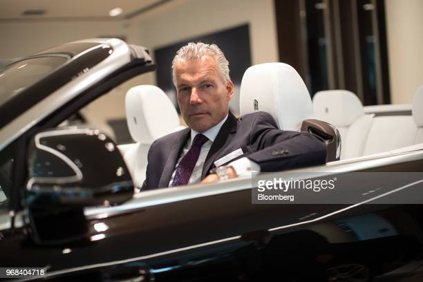 Ttorsten Mullerotvos Chief Executive Officer Of Rollsroyce Motor Cars Ltd Sits For A Photograph In