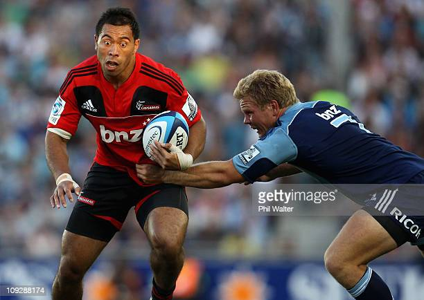 Tu Umaga-Marshall of the Crusaders is tackled by Daniel Braid of the Blues during the round one Super Rugby match between the Blues and the Crusaders...
